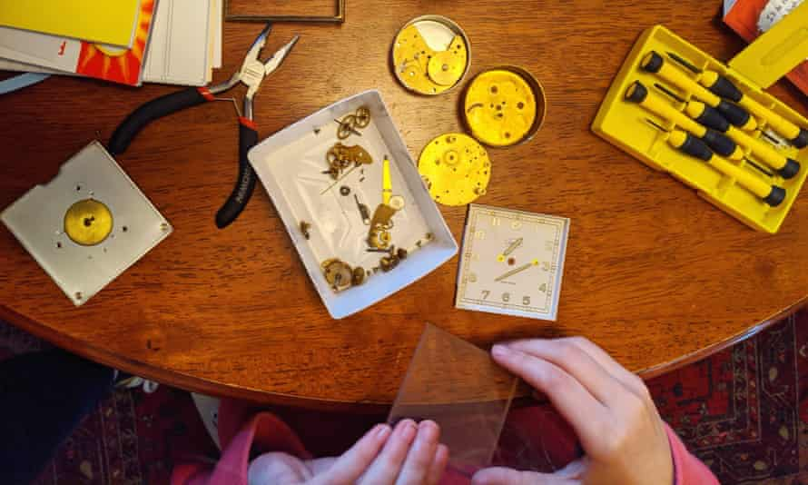 Lily Mae Martin's daughter Anja taking apart a clock to learn about how it works.
