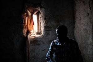 Beni, DRC: Claude Mabowa, 21, an Ebola survivor and student, sits inside what used to be his sister's bedroom