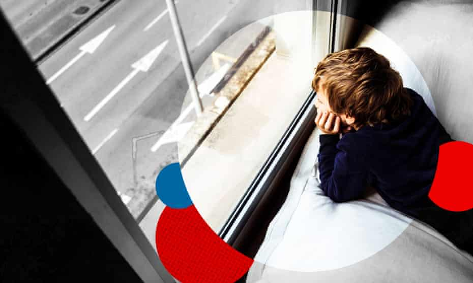 A young person looking out of a window
