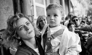 A mother prepares to send her child out of Sarajevo on a bus promised safe passage by the Serb forces during the siege in 1992.