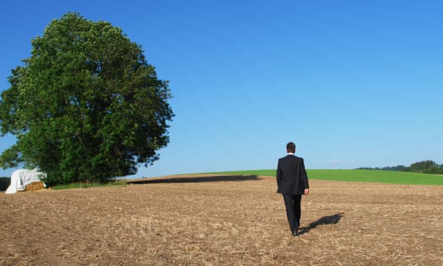 Business Man walking into horizon