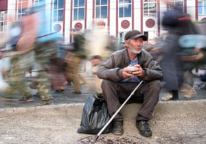 A pilgrim sits after the procession