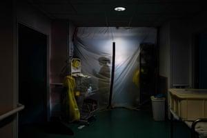 A medical worker prepares to enter the Covid-19 unit of the Hopital Prive de la Loire.