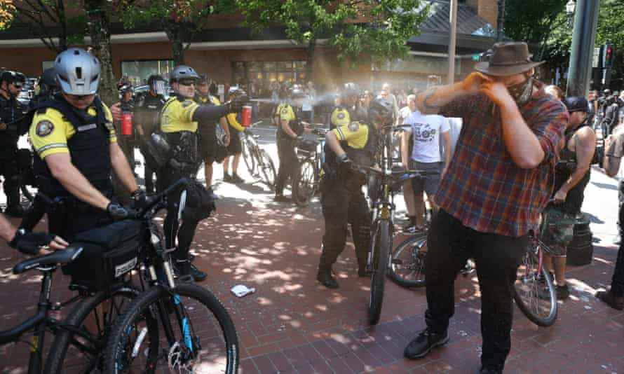 Police use pepper spray as multiple groups protest in downtown Portland.