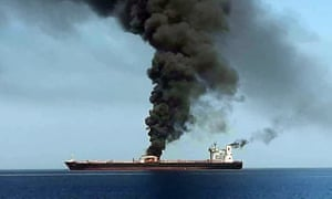 Smoke billows from one of the two oil tankers attacked in the Gulf of Oman