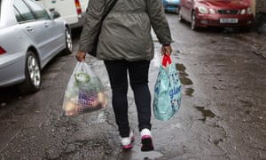 A customer leaving the Arches Food Bank in Loughborough Junction in London