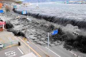 The wave from a tsunami crashes over a street in Miyako, in the Iwate prefecture of north-eastern Japan after the magnitude 8.9 earthquake struck the area. 11 March, 2011.