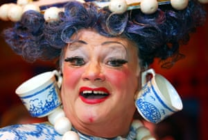 John Inman's Widow Twankey sports his teacups in Aladdin at the Theatre Royal in Newcastle, 2002.