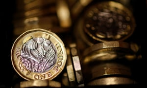 Pound coins are seen in this photo illustration taken in Manchester, Britain September 6, 2017. REUTERS/Phil Noble/Illustration