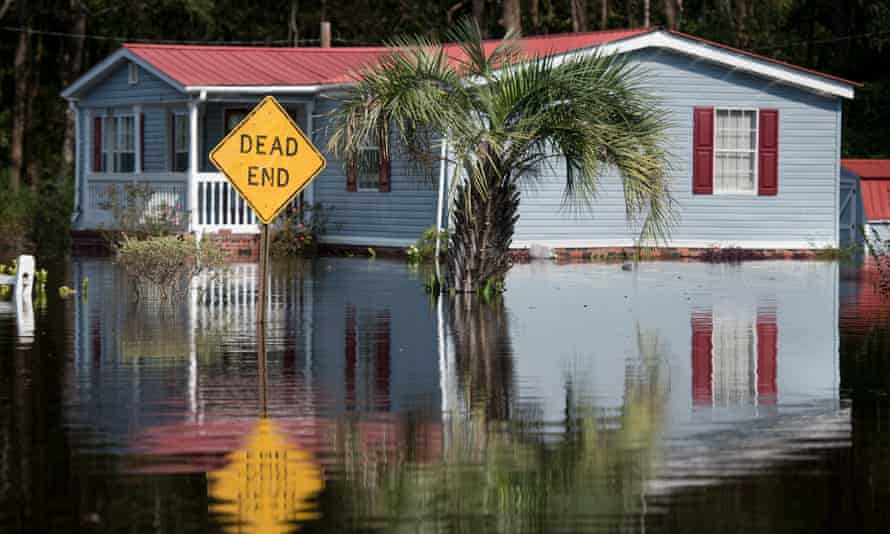 Disaster relief payments to people harmed by hurricanes Florence, above, and Michael have been delayed by the shutdown.