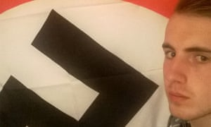 Ethan Stables posing with a Nazi flag.