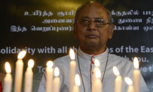 The archbishop of Colombo, Cardinal Malcolm Ranjith looks on during a candle light vigil in memory of the victims on Sunday.