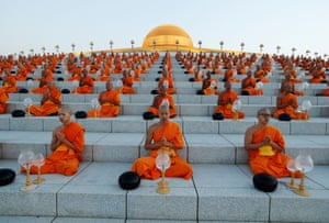 Buddhist monks pray at the Wat Phra Dhammakaya temple during a ceremony to commemorate Makha Bucha Day in Bangkok, Thailand