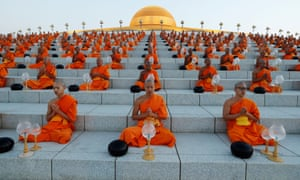 Buddhist monks pray at the Wat Phra Dhammakaya temple in Thailand during a ceremony to commemorate Makha Bucha Day