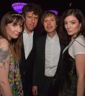 Singer Lorde (on right) with Lena Dunham (on left) and Beck (second right) at a Grammys party, 2017