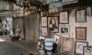 Street artists along Jalan Pintu Besar Selatan where many buildings were burned during the May 1998 riot.