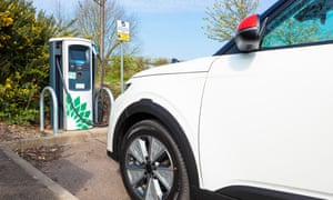 An electric Kia E Soul car being charged