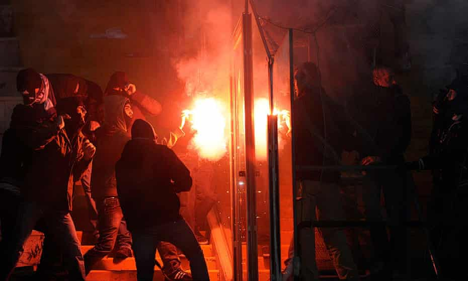 Napoli and Juventus ultras clash at Naples' ground, during a Serie A match on January 9, 2011.