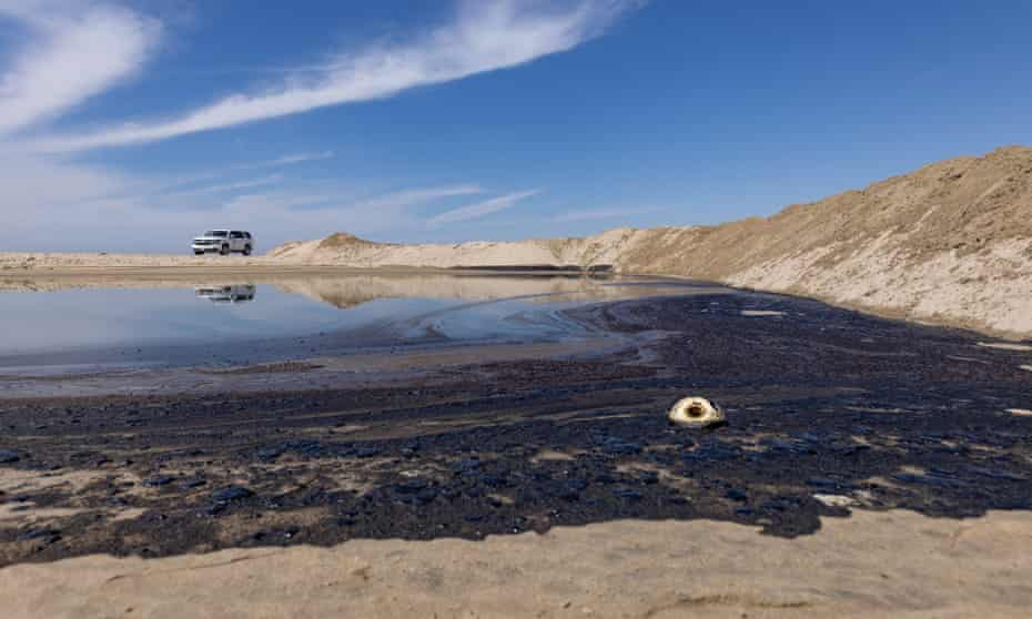 Tar accumulates on the shore after an oil spill off the coast of Huntington Beach, California. According statements by Katrina Foley, Orange county supervisor, the oil spill was caused by a broken pipeline attached to an offshore oil platform.