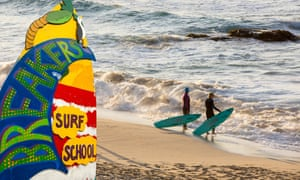 Surfers on Porthmeor beach in St Ives, Cornwall