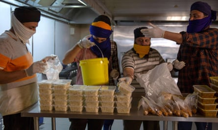 Volunteers from a Sikh temple in Melbourne prepare food deliveries