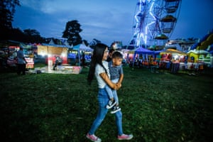 Purba carrying a relative as she walks around the fairground