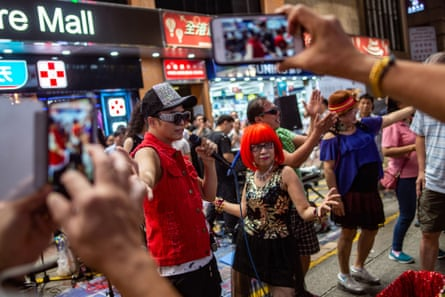 Some of the legendarily noisy Sai Yeung Choi Street South buskers take a final bow.