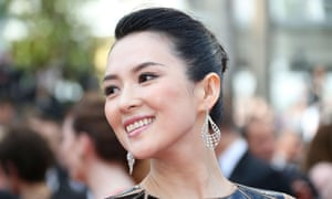 Chinese star Zhang Ziyi poses as she arrives for the opening ceremony of the 67th edition of the Cannes Film Festival. Zhang has accepted a marriage proposal from romantic rock star Wang Feng who delivered a diamond ring to her by drone.
