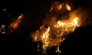 Cooler weather may help crews contain California wildfires – in