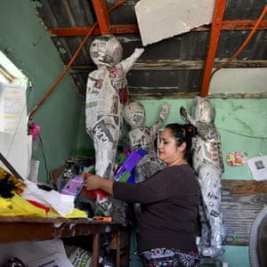 Julia Garcia works making pinatas to sell in Ciudad Acuña