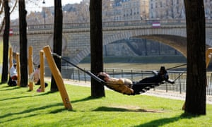 Man lying in a hammock on a sunny day at Parc Rives de Seine, Paris, France.
