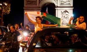 Algeria supporters celebrate in front of the Arc de Triomphe.