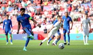 England's Marcus Rashford scores a penalty.