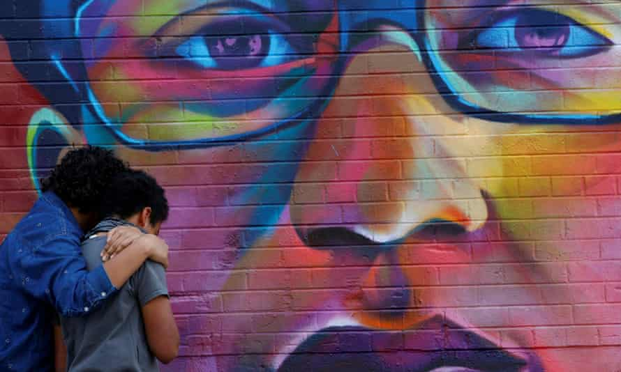 Mourners visit a mural of Elijah McClain, a 23-year-old Black man who died after an encounter with police officers, in Denver, Colorado.
