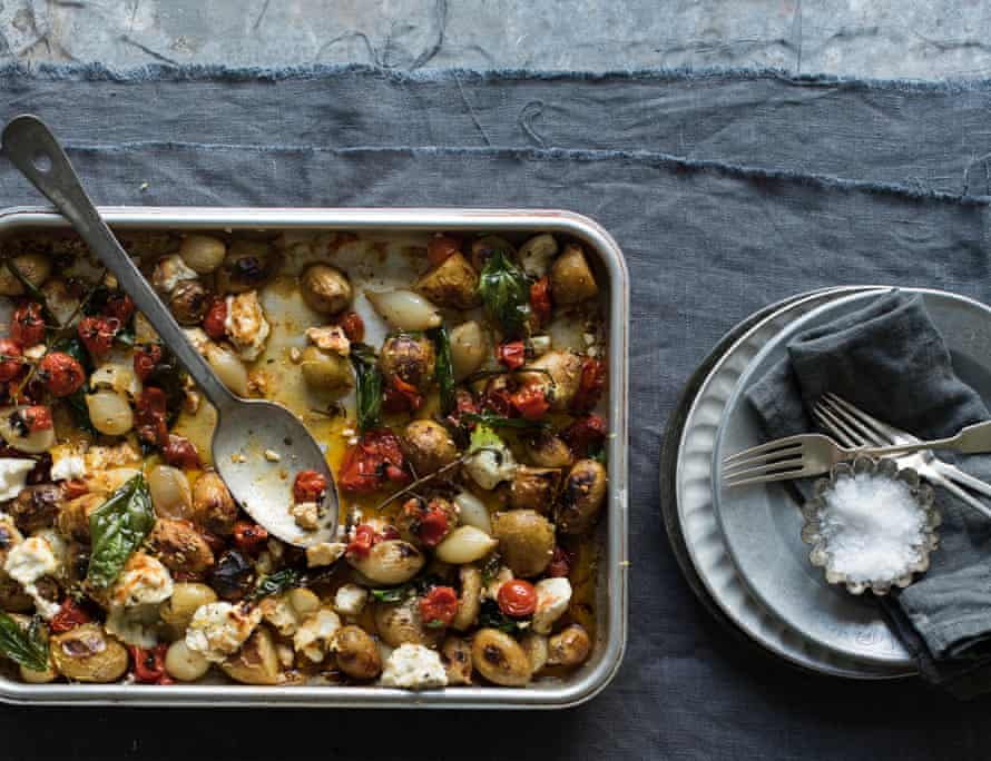 Sweet and sticky roast jersey royal and tomato bake.