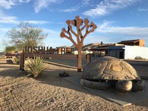 Joshua Tree sign and tortoise sculpture, Joshua Tree, California, US.