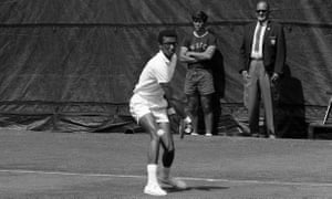 Arthur Ashe keeps his eye on the ball during his match with Clark Graebner in the semi-finals of the U.S. Open Tennis Championships at Forest Hills in the Queens section of New York, Sept. 8, 1968. Ashe stormed into the finals with a 4-6, 8-6, 7-5, and 6-2 victory over his Davis Cup teammate. Men in the background are unidentified. (AP Photo)