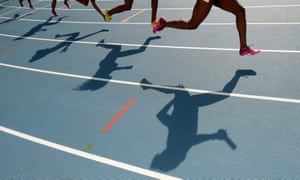 athletes run on a track