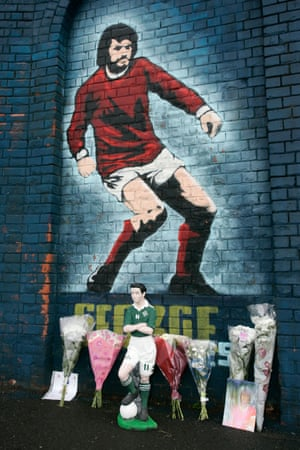 Tributes left underneath the George Best mural at Windsor Park in Belfast.