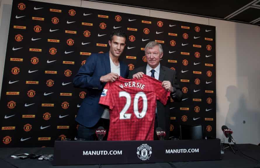 Van Persie poses alongside Sir Alex Ferguson after signing from Arsenal