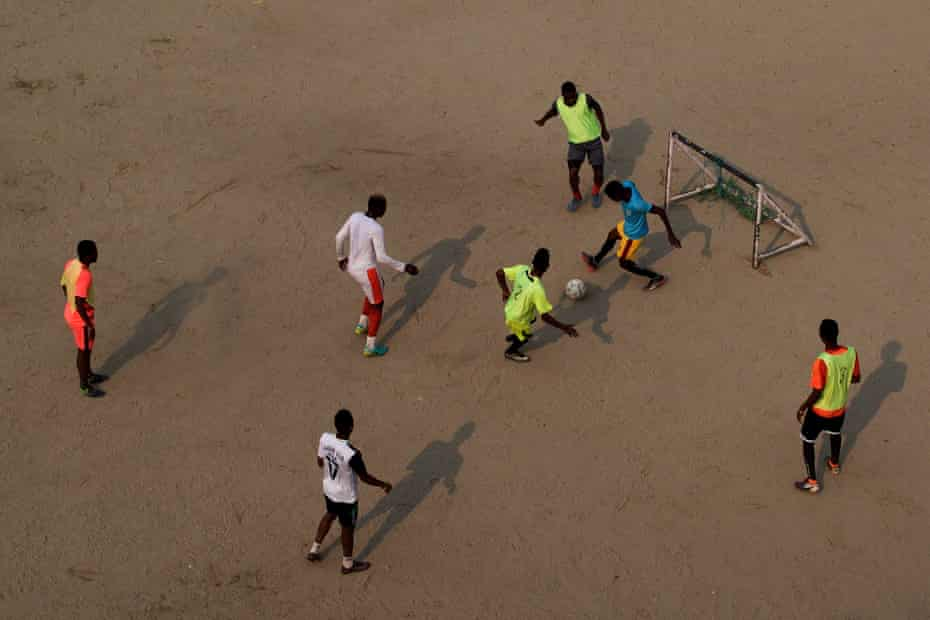 Footballers from west Africa practise at a ground in Naya Bazar in central Kathmandu