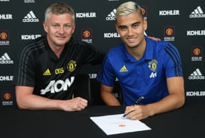 Andreas Pereira of Manchester United poses with Ole Gunnar Solskjær after signing a new contract with the club.