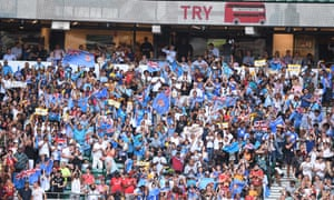 Fiji fans cheer a try from their team.