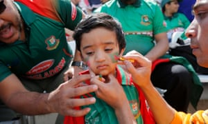 A young Bangladesh fan has his face painted before the match against Australia.