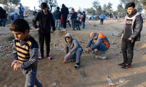 Children play at a makeshift camp for refugees and migrants on the island of Lesbos.