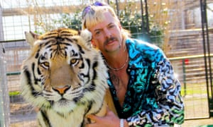Joe Exotic with one of his tigers in Tiger King.