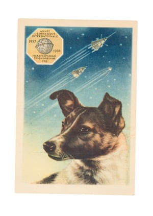 A 1958 postcard featuring a portrait of Laika by the artist E Bundobin, with the first three sputniks shown in the background.
