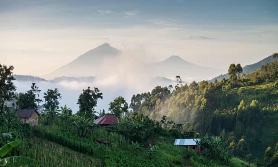 Two volcanic peaks beyond jungle hills