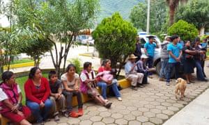 People gather in Santiago Nuyoó's main square to hear about how the new mobile phone network works.