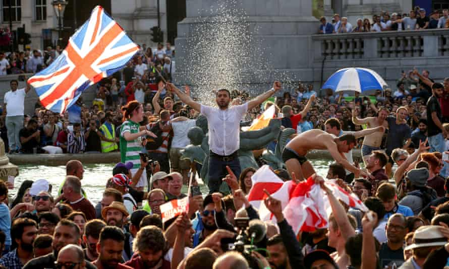 England fans celebrate in Trafalgar Square after watching England win the Cricket World Cup final